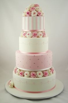 pink and white 4 tier wedding cake adorned with flowers - All Beauty all the Time