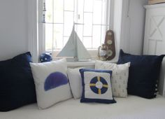 Nautical baby room, nautical boys bedroom, baby boy bedroom ideas, nautical baby room idea, blue baby room, blue baby boys room, how to decorate a baby room, anchors in baby room, navy and white baby room, scatter cushions, boat mirror, nautical decor ideas, baby room decor ideas, whale scatter cushion