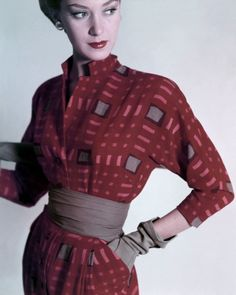"""""""Model is wearing a burgundy and gray dress with a gray waist band and gray cotton gloves, all by Mildred Orrick, February 1948."""" #vintage #fashion #1940s"""