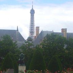 Paris. The Thinker and Eiffel Tower from the gardens at Musee Rodin