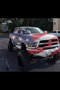 Merica... Pretty awesome lookin Dodge Cummins with a Road Armor Bumper. Who needs a flag when you have a flag truck, haha
