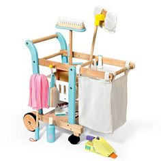 """Housekeeping Cart Set from FAO Schwarz includes a laundry/trash bag, broom, dust mop, whisk broom, duster, hand vacuum, and """"detergent"""" and """"cleaner""""."""