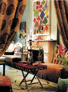 What a fabulous eclectic look. Love the playing card symbol artwork on the wall. By Muriel Brandolini.