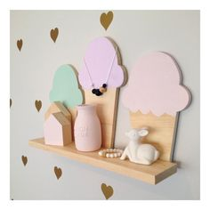 Our Ice Cream coloured shelf is a perfect addition to a nursery or kid's room. Each shelf measures approx.: Shelf Width:50cm Depth: 9cm Our shelves are just the right size without taking up too much space and such a cute addition to any child's room. Also available in a Smaller shelf containing 2 Ice Creams. PLEASE NOTE : This item is RAW with Painted Ice Cream Tips, Painted Cones available in another listing. Custom colours on all shelves are available : Pastel Pink Lemon Yellow Mint Pastel…