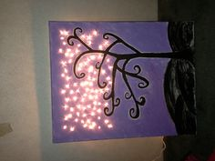 Canvas painted with string lights pokes through.