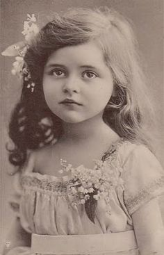 Little flower girl with Lily of the Valley flowers corsage (Date/photographer unknown).