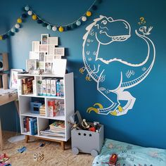 Large T-Rex Dinosaur Wall Decal applied on a bright turquoise wall - Designed by Glue Studio.