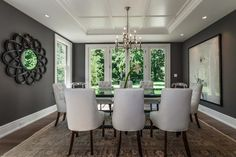 Milton Development: Gorgeous dining room with charcoal gray paint color, atom style mirror, glossy black ...