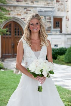 Tara Keely Gown With Ivory Bridal Bouquet