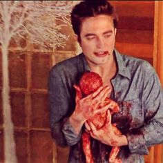 Edward Cullen losing his love and gaining all that is left of her. Renesmee.