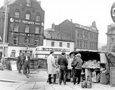 Newspaper Vendor, Fitzalan Square, Bell Hotel, No 9, The Sleep Shop, Bedding Retailers, No 11, Henry Wigfall and Son Ltd., House Furnishers in background