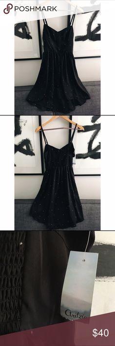 NWT Aritzia Talula Dress Gorgeous black mini-polka dot dress from Aritzia. New with tags! Aritzia Dresses