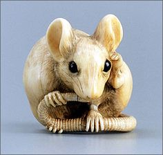 """a rat licking its tail"" by Masanao of Kyoto (active around 1781), Japan, mid- to late 18th century. Stained ivory and horn (Museum of Fine Arts, Boston)"