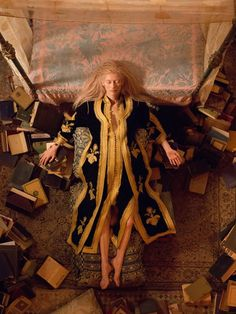 Tilda Swinton in black and gold embroidered caftan