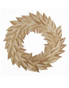 Paper Leaf Wreath  The tutorial is here:  http://www.countryliving.com/crafts/projects/diy-paper-wreath-today-show-0709?click=main_sr
