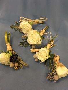 White rose boutonnière with natural grasses by Make it Pretty floral design in Bluffton, SC. Makeitprettyweddings.com