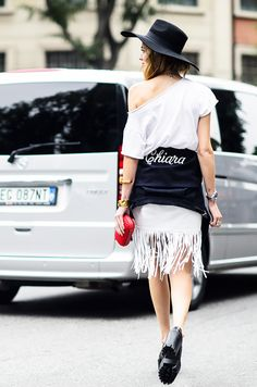 Sweater tied around the waist, plain top, and fringe skirt