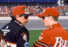 The Earnhardts, Dale Sr. and Dale Jr., talk before a NASCAR Cup race.