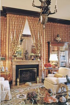 Billy Baldwin - Babe Paley's New York apartment decorated by Billy Baldwin.....note fabric covered walls...mirror over fire place.....elegant.