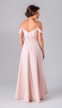 A boho-inspired off the shoulder bridesmaid dress.