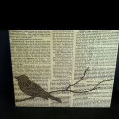 This is just old book pages, covering a flat canvas with modge podge and the branch and bird cut with my cricut! Easy!!!