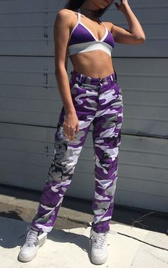 """Purple Camo Pants :  Vendor: Frankie CollectiveType: BottomsPrice: 59.00  Purplecamouflage pants featuring adjustable waist tabs button fly and drawstring bottoms.  SizesXSWaist23-27"""" /Inseam29  - 32  /Hip40SWaist27-31"""" /Inseam29  - 32  /Hip44MWaist31-35"""" /Inseam29  - 32  /Hip48  Extra Small worn on model    Sizes run big"""
