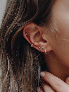 Are Ear Piercings Draining Your Energy? Natural Beauty Are Ear Piercings Draining Your Energy? Natural Beauty The post Are Ear Piercings Draining Your Energy? Natural Beauty appeared first on Ohrringe ideen. Daith Piercing, Ear Peircings, Cute Ear Piercings, Ear Piercings Conch, Body Piercings, Anti Tragus, Ear Piercings Cartilage, Multiple Ear Piercings, Crazy Piercings