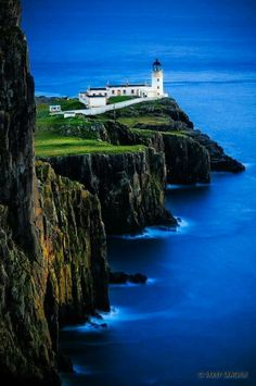 The lighthouse at Neist Point on the Isle of Skye, Scotland. The colors are amazing I have had the honor of traveling much of Scotland and the Isle of Skye is one of the most picturesque places on earth. Places Around The World, Oh The Places You'll Go, Places To Travel, Places To Visit, Around The Worlds, Lighthouse Pictures, Belle Photo, Dream Vacations, Vacation Travel