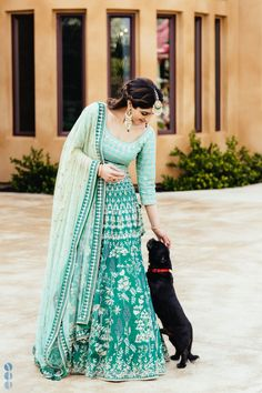 The aqua hued 'Gul Mauhar' Lehenga is inspired by the majestic forests of Ranthambore. It is named after the beautiful Mayflower Tree. Indian Dresses, Indian Outfits, Indian Clothes, Pakistani Dresses, Indian Bride Poses, Rimple And Harpreet Narula, Pakistan Wedding, Wedding Week, Wedding Bride