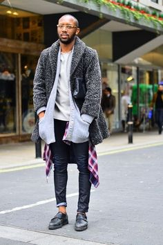 Shop this look on Lookastic:  https://lookastic.com/men/looks/fur-coat-cardigan-long-sleeve-shirt-crew-neck-t-shirt-skinny-jeans-double-monks/5368  — Black Leather Double Monks  — Black Skinny Jeans  — Purple Plaid Long Sleeve Shirt  — Grey Crew-neck T-shirt  — Grey Knit Cardigan  — Grey Fur Coat