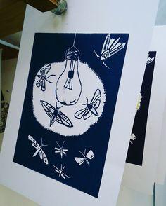 My new #print. #Moths around a #lightbulb #drawntothelight #linoprint
