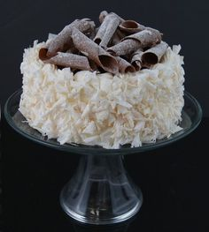 This imitation coconut cake, topped with chocolate curls will dress up any dessert table. Set upon a glass pedestal, this makes a beautiful centerpiece. Chocolate Swirl, Chocolate Curls, Food Artists, Fake Cake, Felt Food, Food Items, Amazing Cakes, Real Food Recipes, Cake Decorating