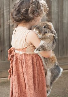 sweet little girl with her rabbit