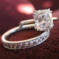 Cushion cut solitaire and eternity band by Leon Mege. ♥