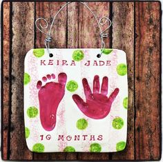 Sweet little hand and foot print impressions in clay with pink stripe and lime green polka dots! Created by artists at Art by You at Weirdgirl Creations Pottery Studio in Barrington RI