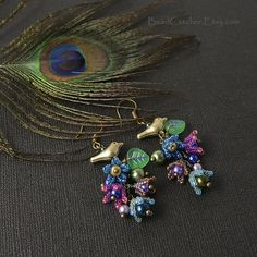 Peacock's garden earrings wit beaded flower bells by BeadCatcher on Etsy
