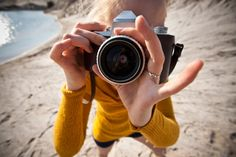 close up photo of a photographer pointing lens into camera