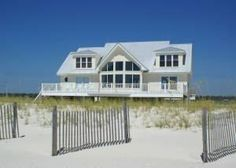 "Gulf Shores, AL: Your family will want to ""linger longer"" at this 6 bedroom, 5 and one half bath Gulf Shores Beach house. Completely re-constructed, this multi-level h..."