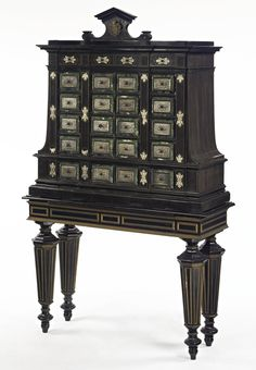 A GERMAN BAROQUE STYLE EBONY AND MAHOGANY, SILVERED AND MARBLE CABINET ON STAND