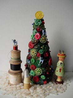 same concept as the ornaments we made last year but with a Styrofoam cone, buttons, and colored straight pins