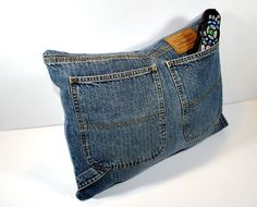 cute pillow idea  ~We used to make purses out of our jeans in High School, and embroider all over them and add beads and sequins.  Love how things come back around!~