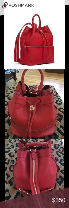 "Tory Burch RED Robinson pebbled backpack purse Lovely Tory Burch backpack that was purchased from Neiman Marcus online.  Only used a handful of times - Looks almost new!!!  Description from the NM web site:  Tory Burch pebbled leather backpack/bucket bag. Shiny yellow-golden hardware. Looped top handle with 4.5"" drop. Convertible zip-down shoulder straps with 20"" drop. Drawstring top closure with double-T logo medallion. One exterior zip pocket. Inside, fabric lining. Interior zip and slip…"
