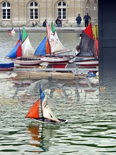 Mini-Sailing boats at Luxemburg Gardens, Paris - Right at the center of the beautiful Gardens of Luxemboug lies the central pool with its small fishes and ducks.You can rent colorful miniature boats your chidren will be more than happy to navigate with a stick through the waters.