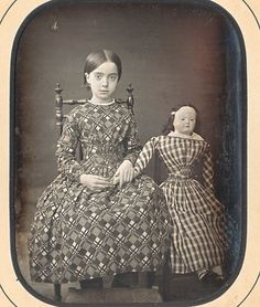 "French quarter plate daguerreotype of child seated side-by-side with a very large doll. 1840s, resealed with original paper mat and backing board. Inscribed on the reverse in period pen ""Alice Bessiere et Regaillette""."
