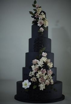 White Wedding Cakes Designed by Victoria Made, this dramatic wedding cake features jet-black fondant accented with lifelike flowers, belladonna berries, and beading. Black And White Wedding Cake, Black Wedding Cakes, Themed Wedding Cakes, Unique Wedding Cakes, Wedding Cakes With Flowers, Beautiful Wedding Cakes, Wedding Cake Designs, Beautiful Cakes, Unique Weddings
