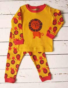 Children's Lion Animal Pyjamas. Handprinted, fun and brightly coloured children's funky pyjamas in yellow.Love this design? We also have the same designs and more in animal printed cushions, t shirts and sweatshirts. Pyjamas are currently available in 1,2,3 and 4 years old. If you spend over £30 with 'Little Dandies' in one transaction you will recieve free delivery to the UK.100% cotton childrens funky pyjamas featuring a handprinted chocolate and orange lion on the front with small l...