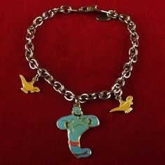 Vintage DISNEY Aladdin Silver Tone Charm Bracelet MV593|We combine shipping|No Question Refunds|Bid $60 for free shipping. Starting at $1