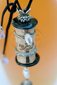 Cork Bella Vintage - Silver Black Label is ONE OF A KIND decorative cork ornament.  Made with an original Black Label Vineyards wine cork.