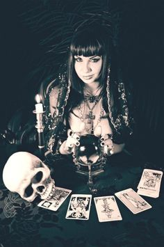 Divination: A fortune-teller with a crystal ball, skull, and Tarot cards.