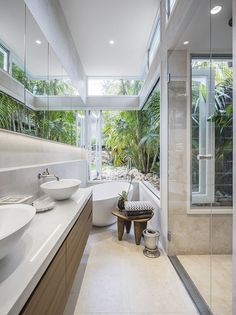 Residential Bathroom, Balmoral by McNally Architects - Relax in this luxury bathroom with bath and shower opening out into the garden #mcnallyarchitects